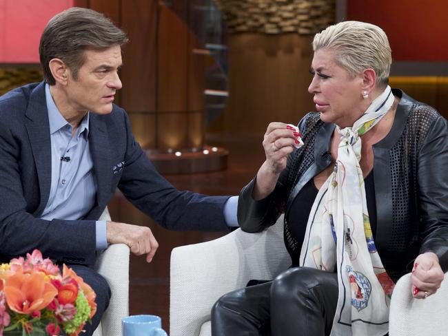 "Earlier this week ... Dr. Mehmet Oz, left, comforts Angela ""Big Ang"" Raiola during a taping of The Dr. Oz Show, in New York. Picture: AP"