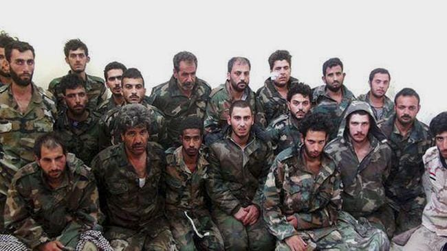 Captured ... this photo posted to a militant website shows Syrian government soldiers captured by Islamic state militants in Palmyra, Syria. Picture: Militant website via AP