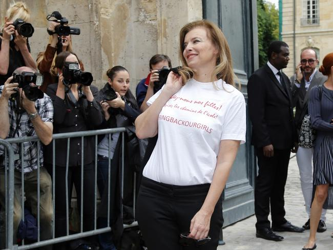 "Sending a message ... Valerie Trierweiler, former companion of French President Francois Hollande, wearing a shirt reading ""Bring back our girls"" poses for photographers before Dior's show."
