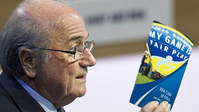 Sepp Blatter shows a copy of the FIFA Code of Ethics.
