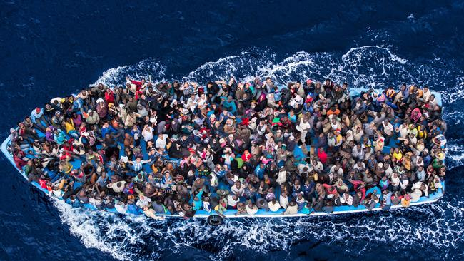 Jammed in ... the Italian navy rescued asylum seekers travelling by boat off the coast of Africa from Libya. They were taken to three Italian ports and likely to be transferred to refugee centres inland. Picture: Massimo Sestini/Polaris, Australscope