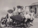 The Williams family of Port Augusta with their sidecar on holidays at Christies Beach in 1959.