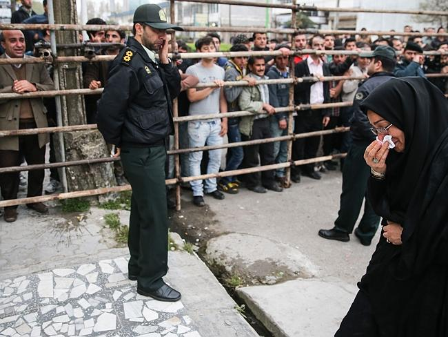 Forgiveness ... Samereh Alinejad cries after she spared the life of her son's convicted murderer with an emotional slap in the face as he awaited execution with the noose around his neck. Picture: AFP /ARASH KHAMOOSHI/ISNA