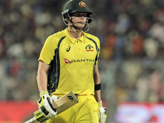 Australia's Steve Smith walks back to the pavilion after being dismissed for 59 runs.
