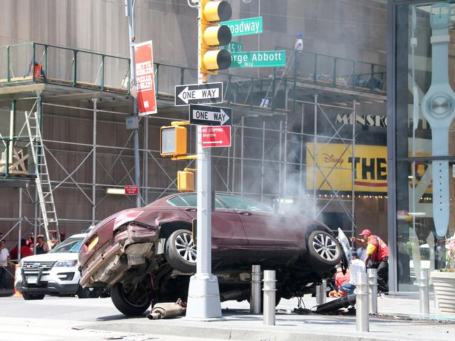 The maroon Honda caught fire after it struck a pole. Picture: Diimex.