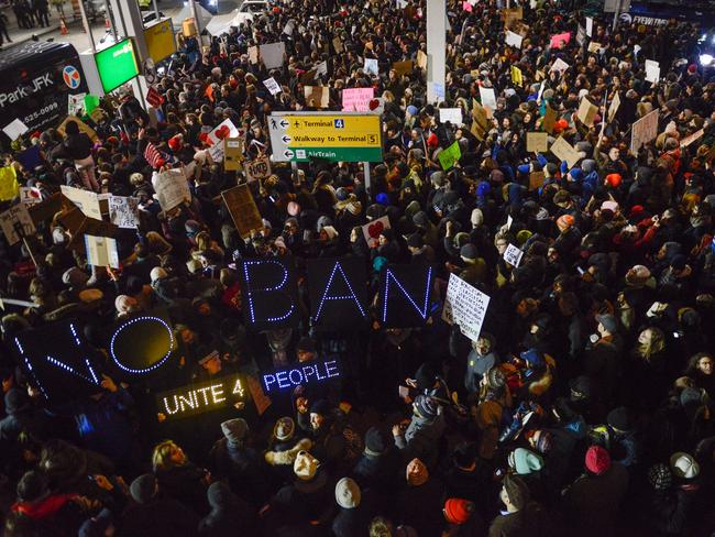 Protesters rally during a demonstration against the Muslim immigration ban at John F. Kennedy International Airport. Picture: Getty