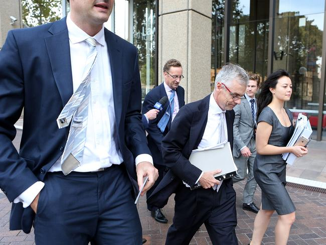 Legal action ... Tom Blackburn (third from left), Gina Rinehart's legal representative, leaves the Supreme Court. Picture: Supplied