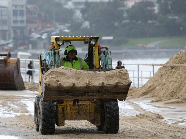 Clean up of sand at Bondi Beach after wild storms. Pic: Craig Wilson