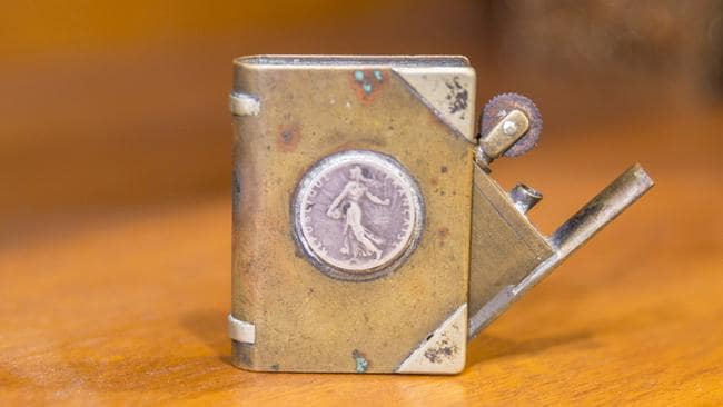 A piece of trench art found at the tip. It's thought to be a home made cigarette lighter fashioned out of bullets from World War One. It's also a little piece of Digger humour, because it's a lighter made to look like a matchbook. Picture: Richard Tuffin.