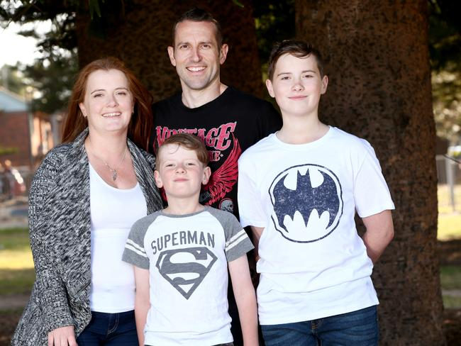 Rachael and Kevin Ben pay their sons Rory and Noah with digital pocket money. Picture: Damian Shaw