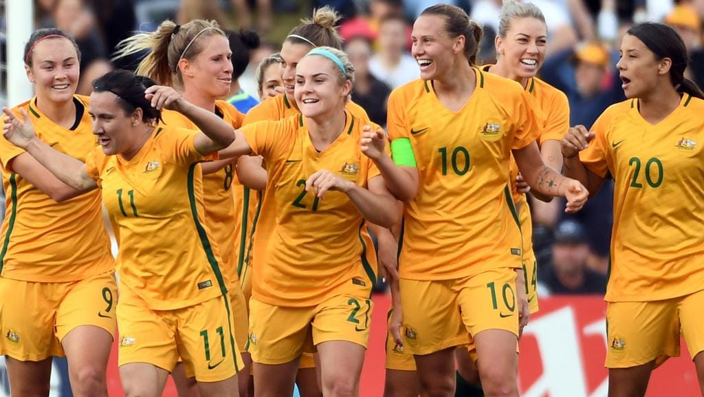 Australia's players celebrate their first goal against Brazil during their friendly women's football match in Sydney on September 16, 2017. / AFP PHOTO / SAEED KHAN / -- IMAGE RESTRICTED TO EDITORIAL USE — STRICTLY NO COMMERCIAL USE —
