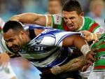 Best Pic Bulldog's Tony Williams attempts to bust the tackle of South Sydney's Sam Burgess during the NRL game between the Canterbury Bankstown Bulldogs and the South Sydney Rabbitohs at ANZ Stadium .Picture Gregg Porteous