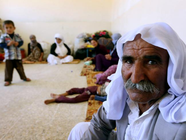 An Iraqi Yazidi family that fled the violence in the northern Iraqi town of Sinjar. The Yazidis, are a small community that follows a 4,000-year-old faith and have been repeatedly targeted by jihadists .Picture: AFP/Safin Hamed