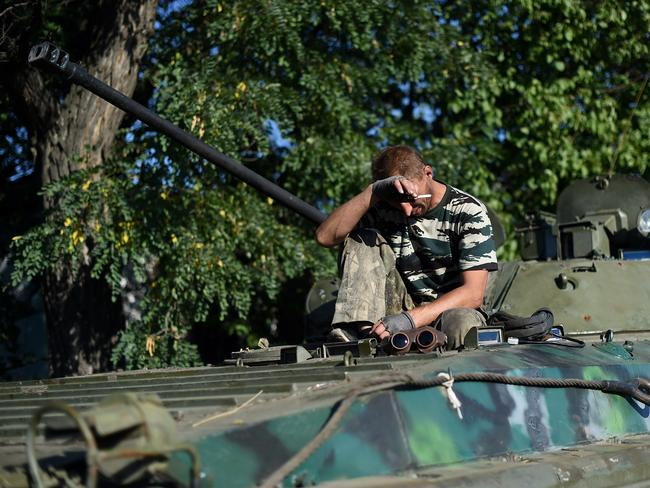 Counter-attack ... Pro-Russian fighters rests on top on a T-64 tank in Starobesheve, southeast of Donetsk, at the weekend. Source: AFP