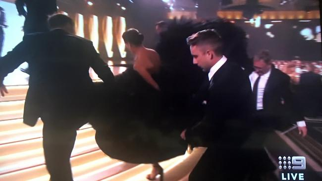 Gorgi Coghlan gets some help with her dress at the 2017 Logies.
