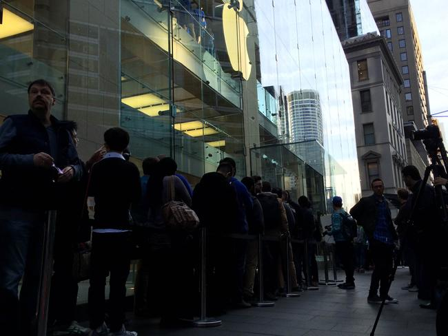Fans queue outside the Sydney Apple store ahead of the new iPhone going on sale. Picture: Harry Tucker