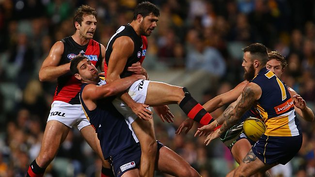 Bomber Patrick Ryder is brought down in a tackle during the first half. Picture: Getty