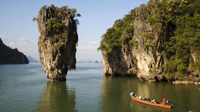 Take a long-tail boat to view Koh Tapu, the so-called James Bond Island in The Man with the Golden Gun.