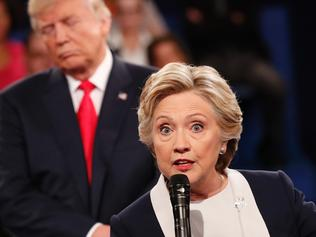 "(FILES) This file photo taken on October 9, 2016 shows Democratic nominee Hillary Clinton (R) and Republican Presidential nominee Donald Trump participate in a town hall debate at Washington University in St. Louis, Missouri. Donald Trump said on November 9, 2016 he would bind the nation's deep wounds and be a president ""for all Americans,"" as he praised his defeated rival Hillary Clinton for her years of public service. / AFP PHOTO / POOL / RICK WILKING"