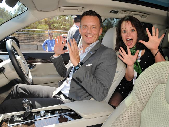 Trent Victor and journalist Katie Spain seemed relaxed about not having their hands to the wheel in the driverless Volvo XC90 on the southern Expressway. Picture: Dave Cronin