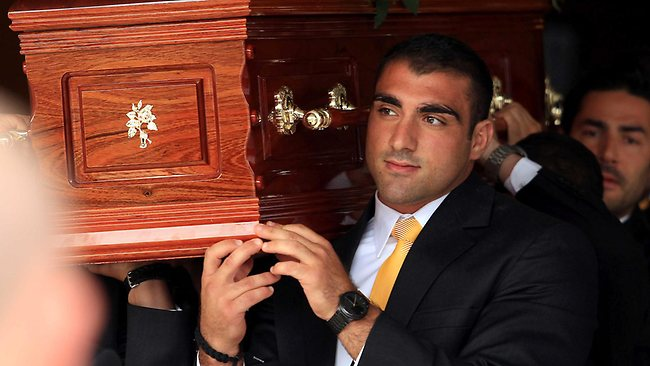 Tim Mannah carries Jon Mannah's casket from the Faith Baptist Church in Regents Park. Picture: Tim Hunter