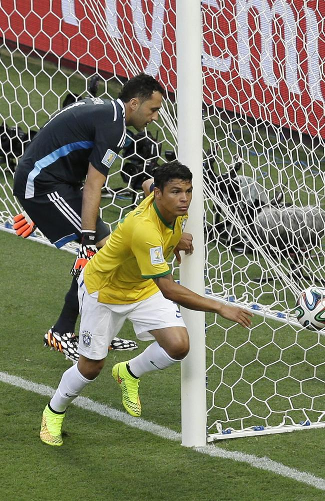 Colombia's goalkeeper David Ospina, left, collects the ball after Brazil's Thiago Silva scores the opening goal during the World Cup quarter-final.