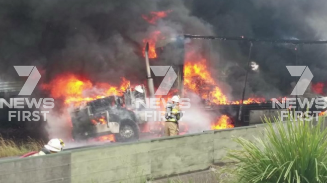 Firefighters battle the blaze that closed the highway in both directions. Picture: 7 News Brisbane