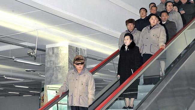 Former North Korea politician leader Kim Jong Il, left, rides an escalator with his sister Kim Kyong Hui, and his son Kim Jo...