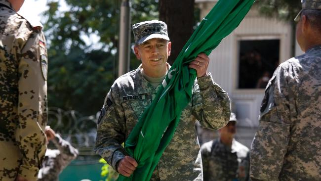 General David Petraeus, the new head of US and NATO forces in Afghanistan, assumes command during a ceremony in Kabul yesterday.