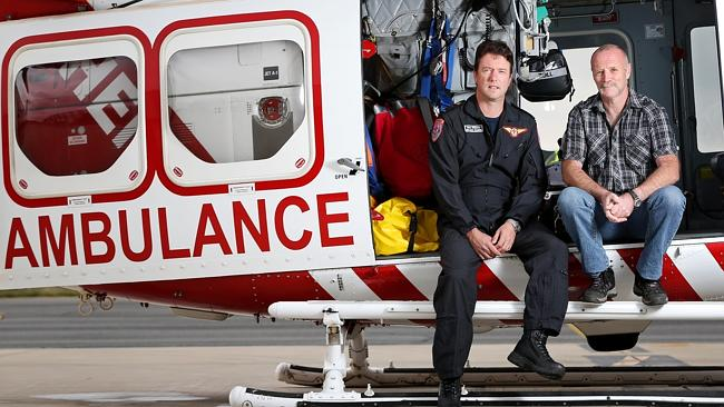 Paramedic Shaun Whitmore is reunited with a recovered Mr Warren after the air crew saved his life. Picture: Mark Stewart