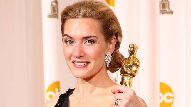 "LOS ANGELES, CA - FEBRUARY 22: (EDITORS NOTE: NO ONLINE, NO INTERNET, EMBARGOED FROM INTERNET AND TELEVISION USAGE UNTIL THE CONCLUSION OF THE LIVE OSCARS TELECAST) Actress Kate Winslet poses after winning the Best Actress award for ""The Reader"" in the press room at the 81st Annual Academy Awards held at Kodak Theatre on February 22, 2009 in Los Angeles, California. (Photo by Jason Merritt/Getty Images)"