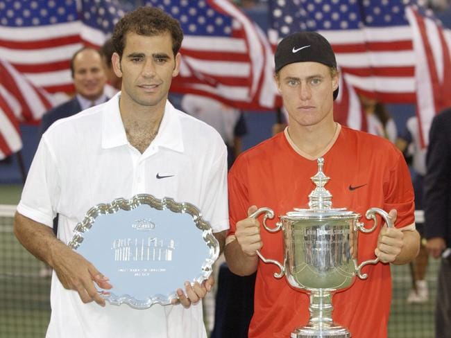 Toppled a giant: Hewitt with the trophy, Sampras with the plate.