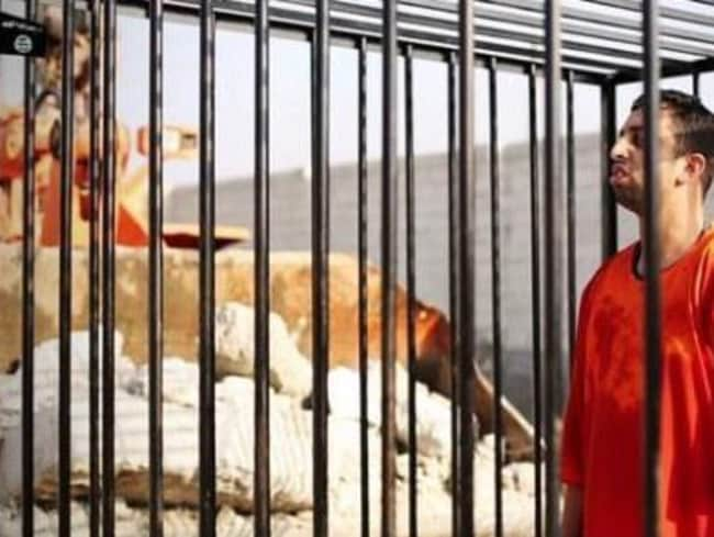 Brutal ... Islamic State video shows the murder of Jordanian hostage Muath al-Kaseasbeh. Picture: Supplied