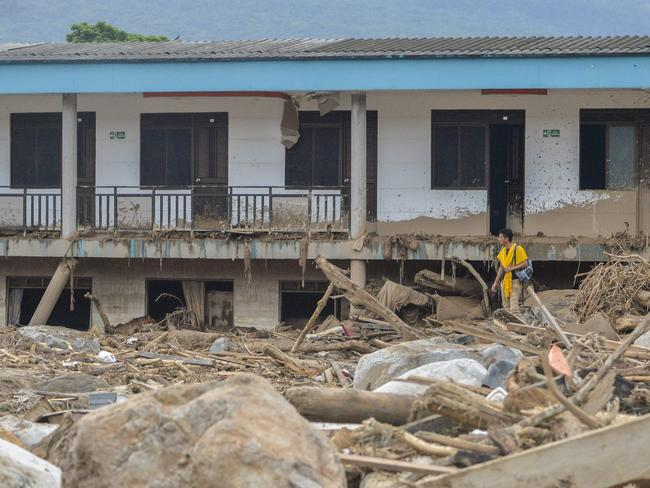 A local stares at the rubble left by mudslides following heavy rains in Mocoa. Picture: AFP