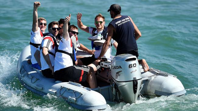 (from L-R) Germany's Bastian Schweinsteiger, Ron-Robert Zieler, Per Mertesacker, Mats Hummels and Benedikt Hoewedes sit on a motorboat during a roundtrip on the Atlantic sea near Santo Andre.