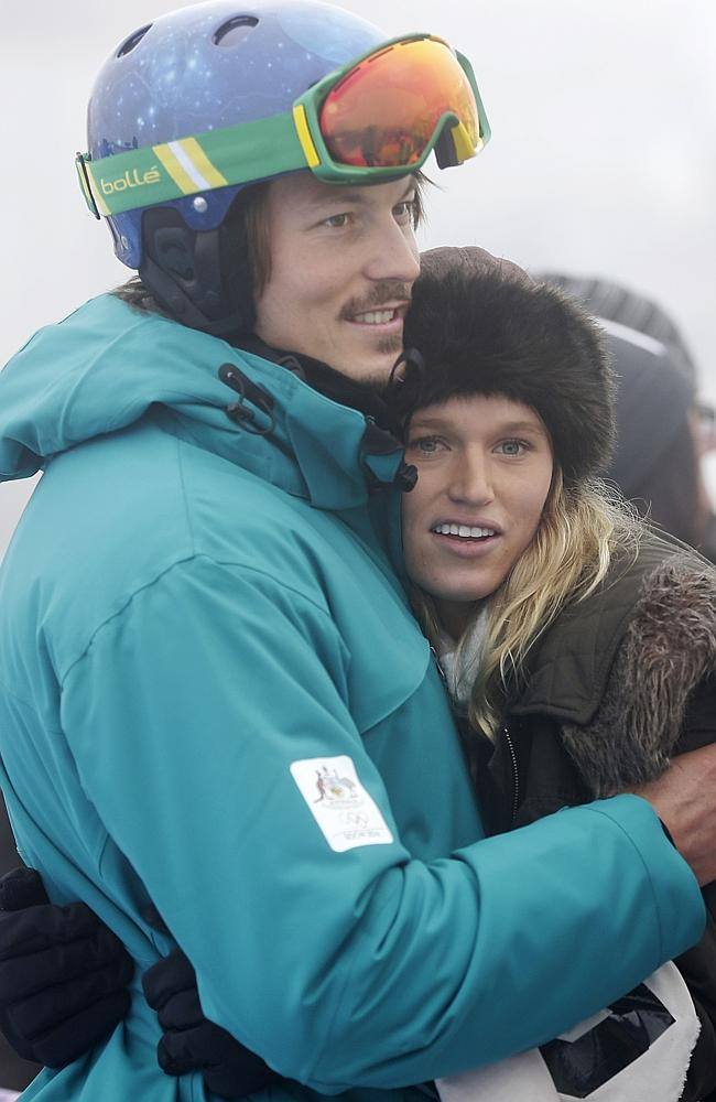 Snowboarder Alex Pullin, left, hugs his girlfriend Ellidy Vlug as his Olympic event is cancelled.