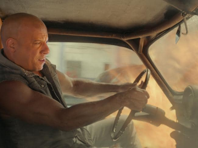 Dom finds Cuban street racing to be hot work in Fate's opening sequence. Picture: Universal Pictures