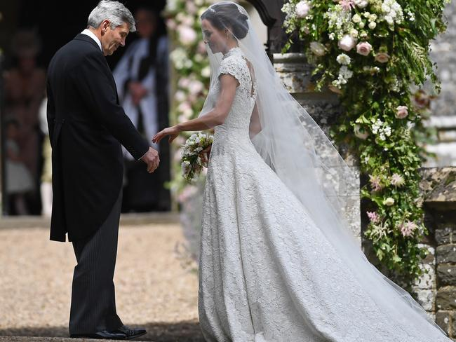 Pippa and her father Michael Middleton outside the church. Photo by Justin Tallis - WPA Pool