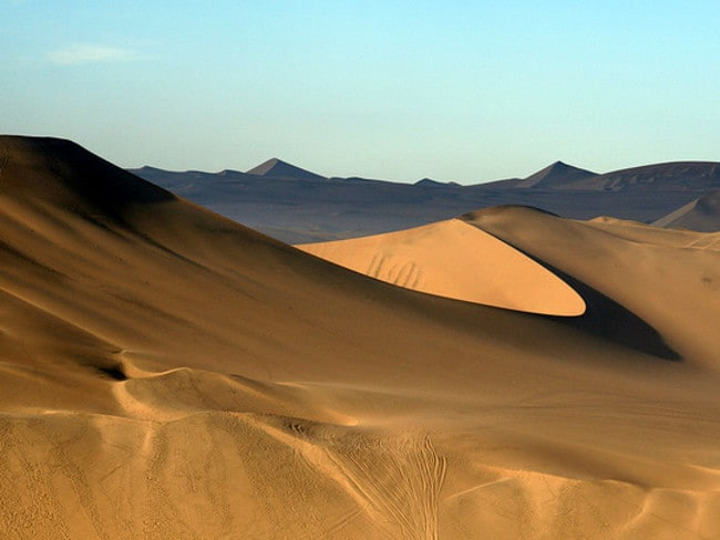 Huacachina is surrounded by huge sand dunes popular with tourists. Picture: ilkerender.