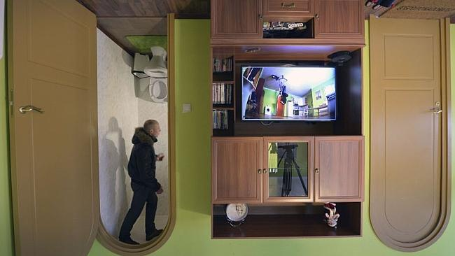 An upside-down loo adds to the home's wacky design. Picture: AFP.