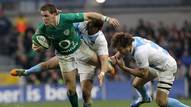 Ireland's Tommy Bowe (L) is tackled by Argentina's Juan Imhoff (C) and Juan Martin Hernandez (R) at the Aviva stadium in Dublin. Ireland won 46-24. Picture: Peter Muhly