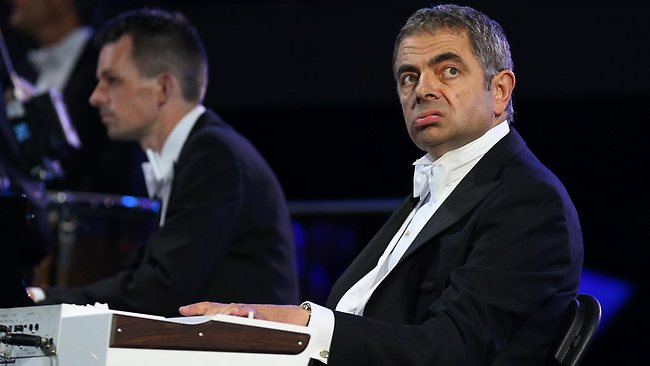 British actor Rowan Atkinson in his role as Mr Bean takes part in the Opening Ceremony.