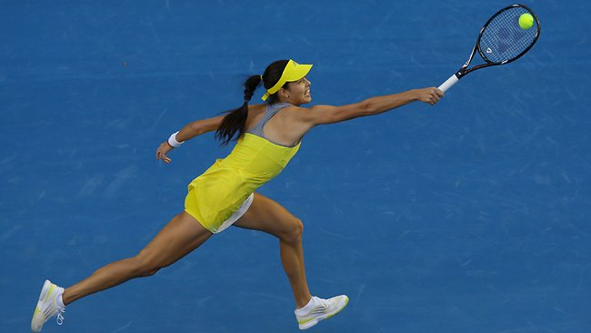Serbia's Ana Ivanovic stretches for a backhand return against Poland's Agnieszka Radwanska. Picture: Aaron Favila