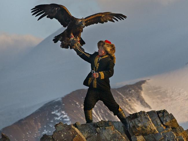 Aisholpan learns to train the eagle in front of a natural spectacular backdrop. Picture: Asher Svidensky