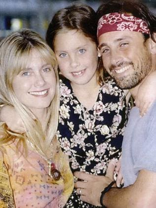 Olivia Newton-John, with daughter Chloe and then husband Matt Lattanzi, in 1993. Picture: Supplied