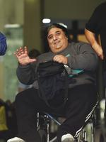 Agapitos (Fat Pete) Megaloudis in wheel chair outside court. The Rebels member was a significant Strike Force Raptor target after it first formed in 2009.