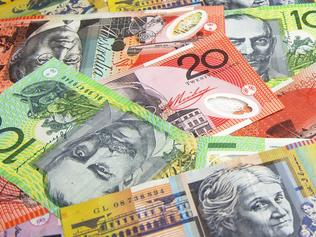 Australian banknotes (cash, currency) spread out in panorama format.  Horizontal, copy space, no complete notes displayed.