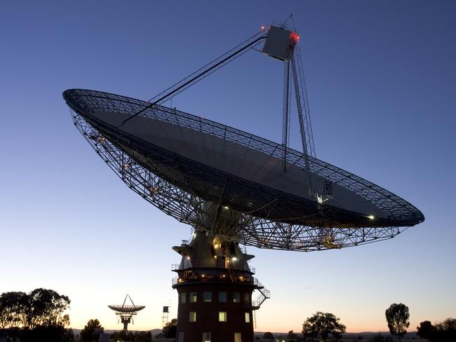 The CSIRO Parkes radio telescope observing in the morning twilight. Picture: Shaun Amy