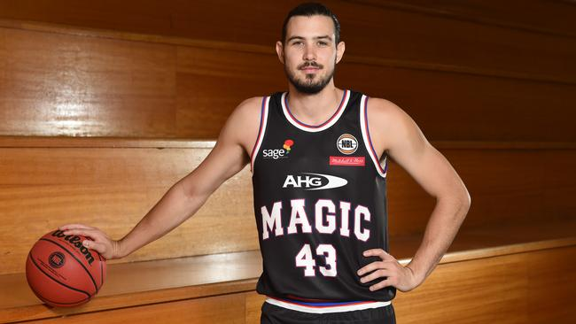 Chris Goulding shows off the uniform Melbourne United will wear for heritage round. Picture: Lawrence Pinder