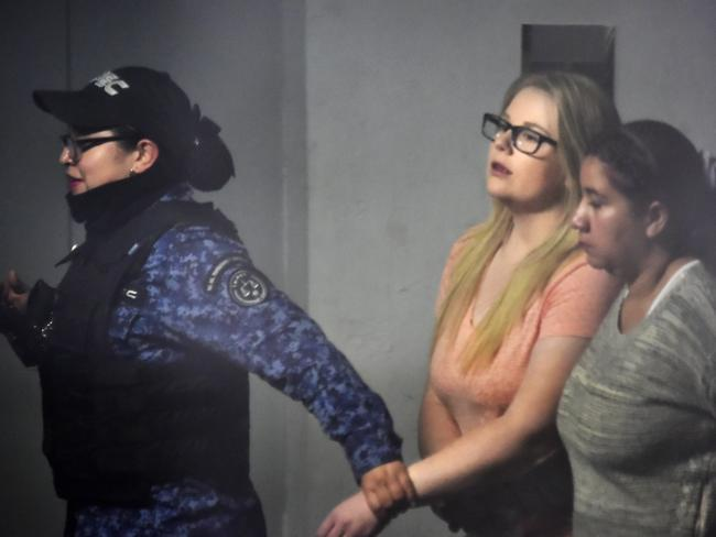 Cassie Sainsbury is led from a Bogota, Colombia, court after defence and prosecution lawyers reached a plea-bargain agreement today. Picture: Guillermo Legaria